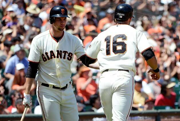 SAN FRANCISCO, CA - JUNE 14:  Angel Pagan #16 of the San Francisco Giants is congratulated by teammate Brandon Belt after scoring on a sacrifice fly from Hector Sanchez #26 in the six inning against the Houston Astros at AT&T Park on June 14, 2012 in San Francisco, California.  (Photo by Thearon W. Henderson/Getty Images) Photo: Thearon W. Henderson, Getty Images