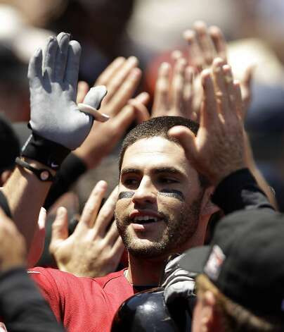 Houston Astros' J.D. Martinez is high-fived in the dugout after his grand slam off San Francisco Giants starting pitcher Barry Zito during the third inning of a baseball game in San Francisco, Thursday, June 14, 2012. (AP Photo/Marcio Jose Sanchez) Photo: Marcio Jose Sanchez, Associated Press