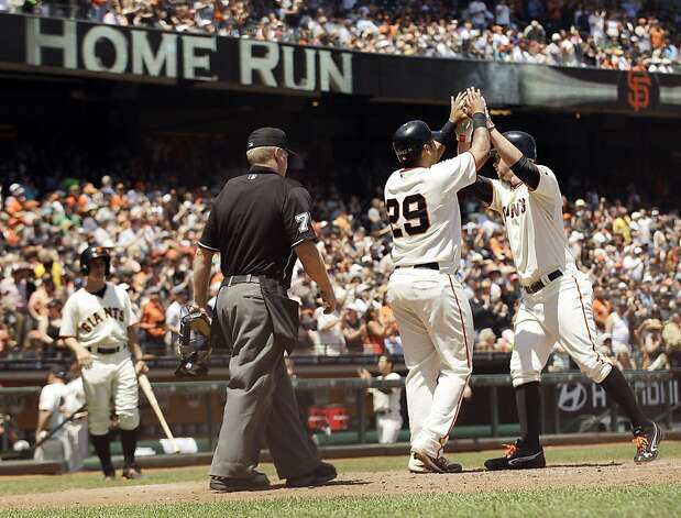 San Francisco Giants' Brandon Belt, right, celebrate his two-run home run with teammate Hector Sanchez (29) during the fourth inning of a baseball game against the Houston Astros in San Francisco, Thursday, June 14, 2012. (AP Photo/Marcio Jose Sanchez) Photo: Marcio Jose Sanchez, Associated Press