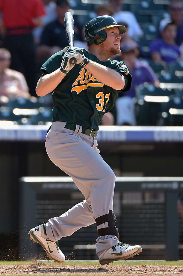 DENVER, CO - JUNE 14:  Brandon Moss #37 of the Oakland Athletics hits a solo home run in the ninth inning against the Colorado Rockies during Interleague Play at Coors Field on June 14, 2012 in Denver, Colorado. The A's defeated the Rockies 8-2.  (Photo by Doug Pensinger/Getty Images) Photo: Doug Pensinger, Getty Images