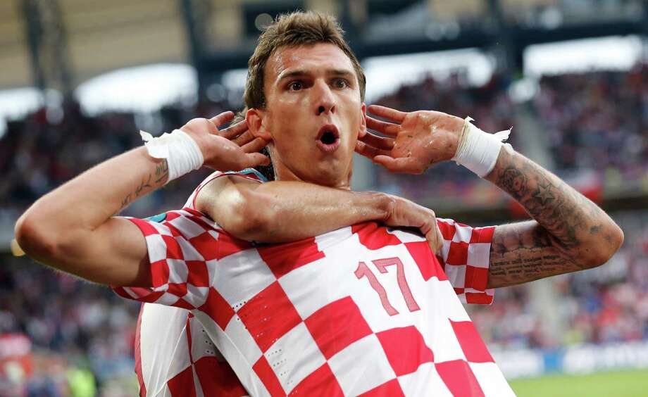 Croatia's Mario Mandzukic celebrates after scoring during the Euro 2012 soccer championship Group C match between Italy and Croatia in Poznan, Poland, Thursday, June 14, 2012. Photo: AP