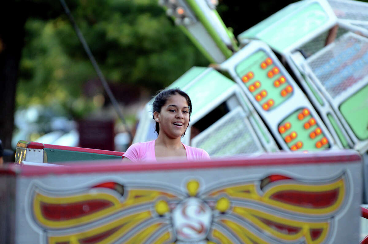 Jessica Esquivel, 14, of Stamford, rides the Scrambler during the First Presbyterian Church's first carnival fundraiser in Stamford on Thursday, June 14, 2012.