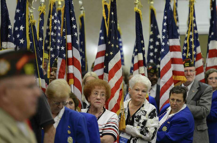 VFW members hold American Flags during the joint opening and Memorial Service of 93rd Annual New York State Convention for the VFW at the Marriott in Colonie, N.Y. Flag Day June 14, 2012. Photo: Matthew Hamilton / 00017952A