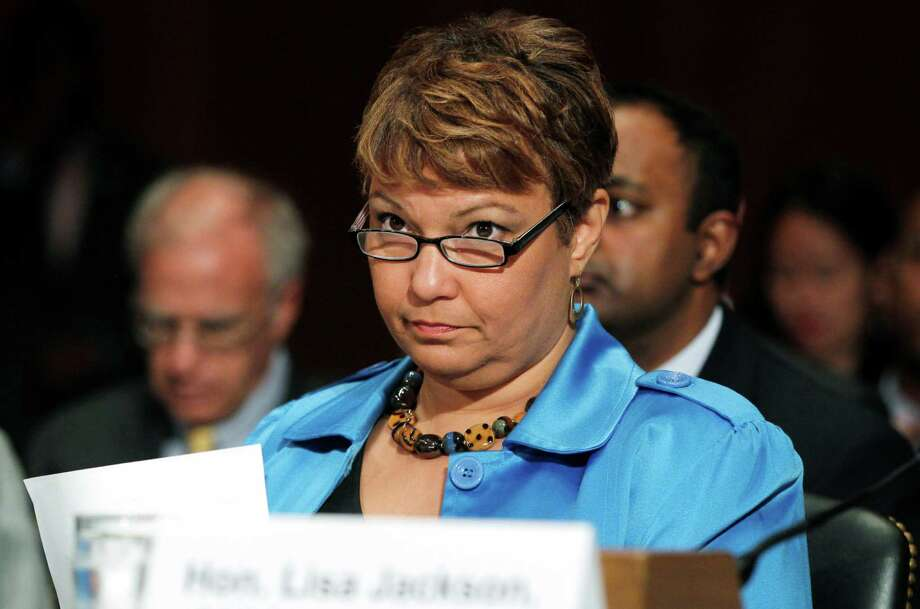 FILE - In this June 15, 2011, file photo Environmental Protection Agency (EPA) Administrator Lisa Jackson testifies before the Senate Committee on Environment and Public Works regarding the Clean Air Act and Public Health on Capitol Hill in Washington. In response to a federal court order requiring the Obama administration to update air quality standards under the Clean Air Act the EPA is proposing new air quality standards to lower the amount of soot that can be released into the air. The long-delayed rule is to be made public on Friday, June 15, 2012.  (AP Photo/Charles Dharapak, File) Photo: Charles Dharapak