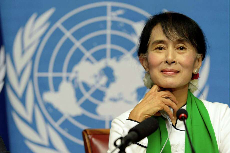 Myanmar opposition leader Aung San Suu Kyi attends a news conference during the annual meeting of the International Labour Organization (ILO) in Geneva, Switzerland, Thursday, June 14, 2012. Suu Kyi said that investment in her country should strengthen its nascent process of democratization. The Nobel peace laureate spoke Thursday to the annual meeting of the ILO in Geneva on the first stop of her trip to Europe. (AP Photo/Keystone, Laurent Gillieron) Photo: Laurent Gillieron