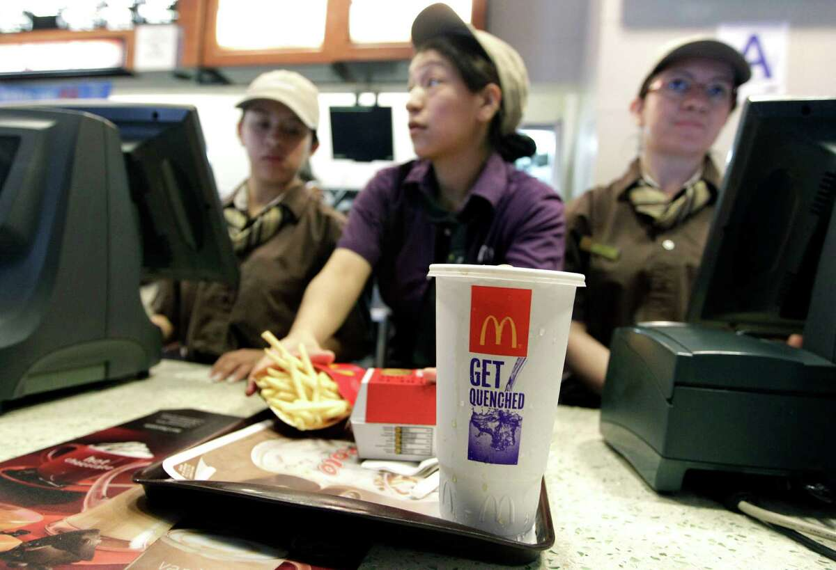 FILE - In this June 12, 2012 file photo, McDonald's employees serve a meal containing a large soda, in New York. If New York City bans big sodas, what's next? Large slices of pizza? Double-scoop ice cream cones? Tubs of movie-theater popcorn? The 16-ounce strip steak? Opponents of the proposed ban may use that slippery-slope argument along with other legal strategies to try to block the first-in-the-nation rule. (AP Photo/Mary Altaffer, File)