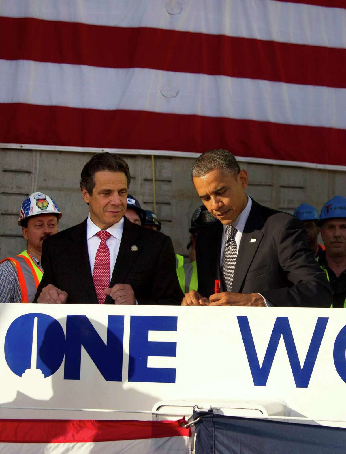 New York Gov. Andrew Cuomo watches as President Barack Obama signs a white steal beam as they visit the Port Authority of New York and New Jersey's World Trade Center site for a briefing on construction progress, Thursday, June 14, 2012, in New York. (AP Photo/Carolyn Kaster)