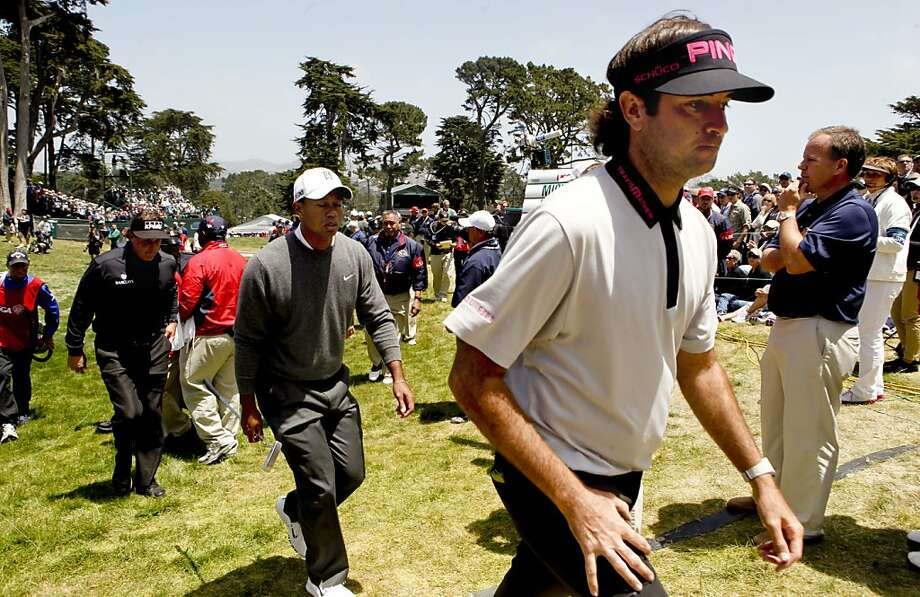 Phil Mickelson, Tiger Woods  and Bubba Watson walking from the eighth hole, as they finished play for the day, during the first round of the United States Open Championship at the Olympic Club in Daly City, Ca., on Thursday June 14, 2012. Photo: Michael Macor, The Chronicle