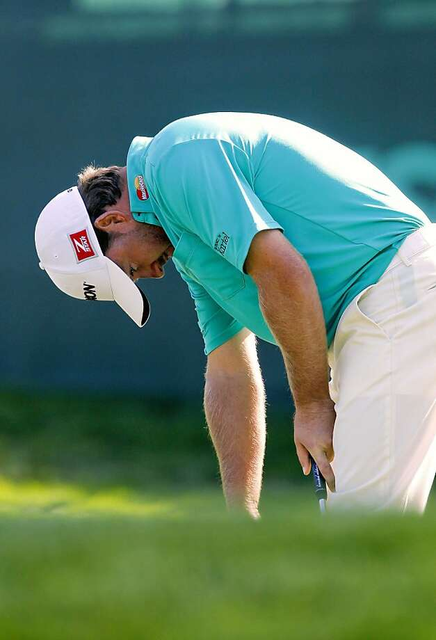 Graeme McDowell hangs his head after just missing a birdie putt on the seventeenth hole, during the first round of the United States Open Championship at the Olympic Club in Daly City, Ca., on Thursday June 14, 2012. Photo: Michael Macor, The Chronicle