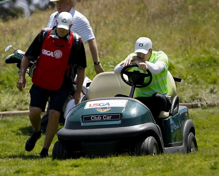 Casey Martin looked pensive as he talked with his caddy as they moved down the second hole. The first round of the 2012 U.S. Open was held at The Olympic Club in San Francisco, Calif. Thursday June 14, 2012 Photo: Brant Ward, The Chronicle