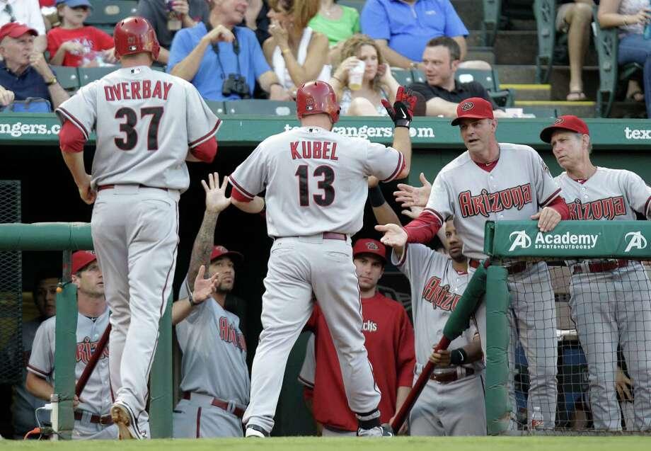 Arizona Diamondbacks designated hitter Jason Kubel (13) is congratulated during the second inning of a baseball game against the Texas Rangers in Arlington, Texas, on Thursday June 14, 2012. Photo: AP