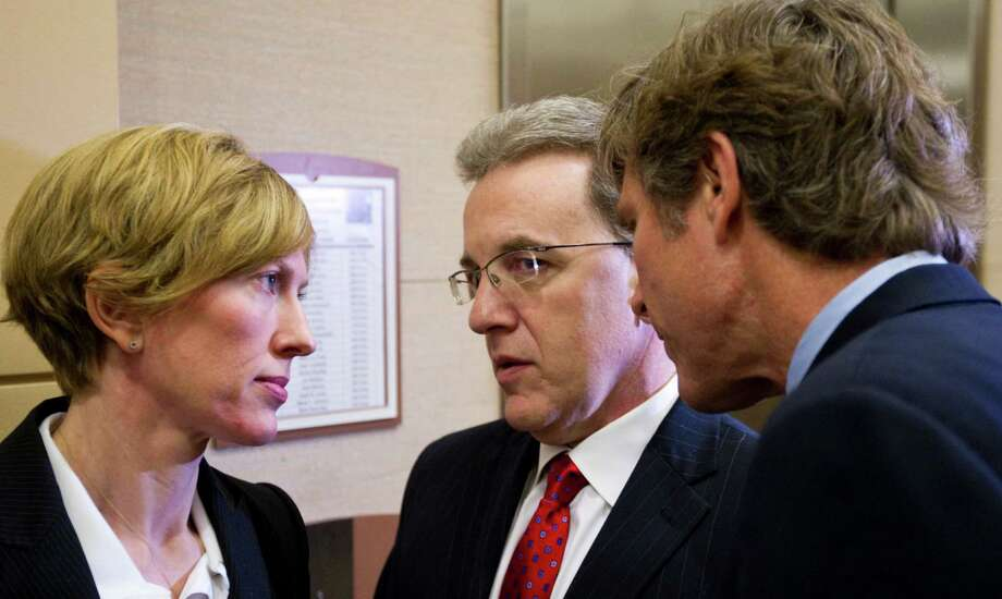 Jeffrey Stern, center, chats with his legal team after leaving state District Judge Denise Bradley's courtroom on Thursday. Photo: Nick De La Torre / © 2012  Houston Chronicle