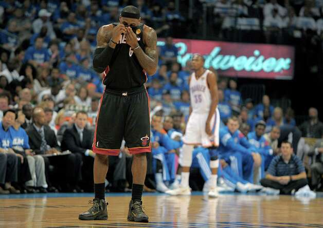 The Miami Heat's LeBron James wipes the sweat out of his eyes during the first quarter in Game 2 of the NBA Finals against the Oklahoma City Thunder on Thursday, June 14, 2012, at Chesapeake Energy Arena in Oklahoma City, Oklahoma. (Michael Laughlin/Sun Sentinel/MCT) Photo: Michael Laughlin, McClatchy-Tribune News Service / Sun Sentinel