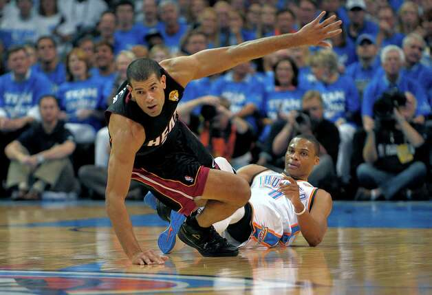 The Miami Heat's Shane Battier gets up after being knocked down while setting a screen on the Oklahoma City Thunder's Russell Westbrook, right, during the first quarter in Game 2 of the NBA Finals on Thursday, June 14, 2012, at Chesapeake Energy Arena in Oklahoma City, Oklahoma. (Michael Laughlin/Sun Sentinel/MCT) Photo: Michael Laughlin, McClatchy-Tribune News Service / Sun Sentinel