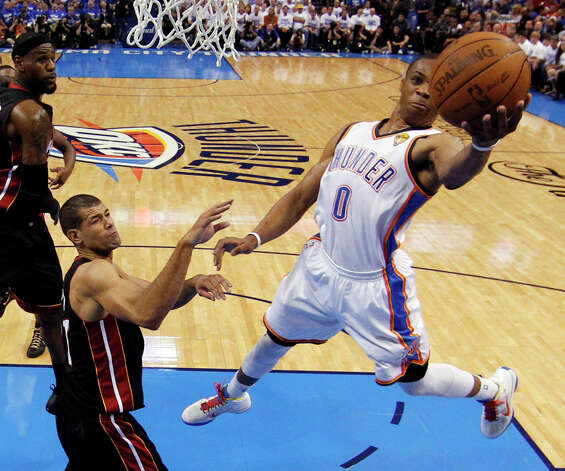 Oklahoma City Thunder point guard Russell Westbrook (0) shoots around Miami Heat small forward Shane Battier during the first half at Game 2 of the NBA finals basketball series, Thursday, June 14, 2012, in Oklahoma City. (AP Photo/Jim Young, Pool) Photo: Jim Young, Associated Press / Reuters Pool