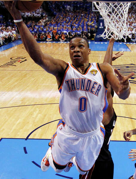 Oklahoma City Thunder point guard Russell Westbrook shoots against the Miami Heat during the first h