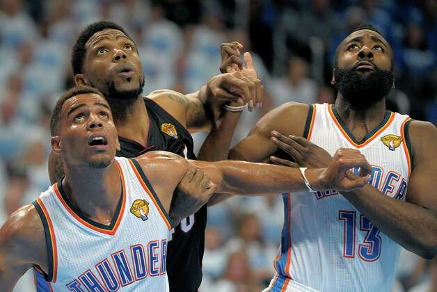 The Miami Heat's Udonis Haslem is boxed out by the Oklahoma City Thunder's Thabo Sefolosha, left, and James Harden, right, during the first quarter in Game 2 of the NBA Finals on Thursday, June 14, 2012, at Chesapeake Energy Arena in Oklahoma City, Oklahoma. (Michael Laughlin/Sun Sentinel/MCT) Photo: Michael Laughlin, McClatchy-Tribune News Service / Sun Sentinel
