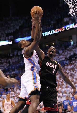 The Miami Heat's Chris Bosh (1) stuffs a shot by the Oklahoma City Thunder's Serge Ibaka in the first quarter in Game 2 of the NBA Finals on Thursday, June 14, 2012, at Chesapeake Energy Arena in Oklahoma City, Oklahoma. (Al Diaz/Miami Herald/MCT) Photo: Al Diaz, McClatchy-Tribune News Service / Miami Herald