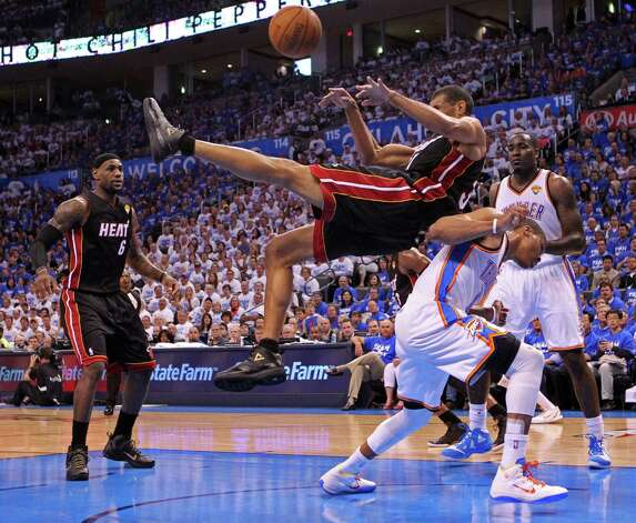 The Miami Heat's Shane Battier crashes into the Oklahoma City Thunder's Nazr Mohammed on a defensive rebound in the first quarter in Game 2 of the NBA Finals on Thursday, June 14, 2012, at Chesapeake Energy Arena in Oklahoma City, Oklahoma. (Al Diaz/Miami Herald/MCT) Photo: Al Diaz, McClatchy-Tribune News Service / Miami Herald