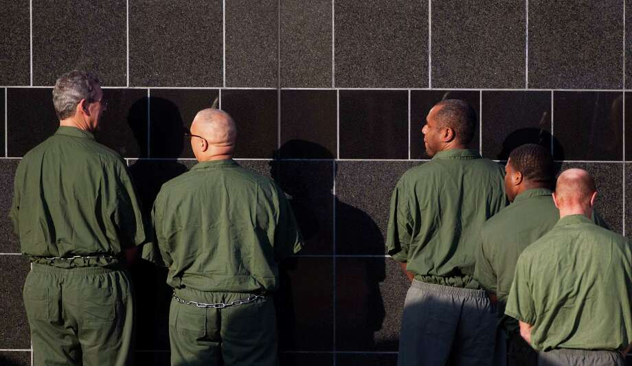 R. Allen Stanford, left, enters the Bob Casey Federal Courthouse with other prisoners. Photo: Johnny Hanson, Houston Chronicle / © 2012  Houston Chronicle