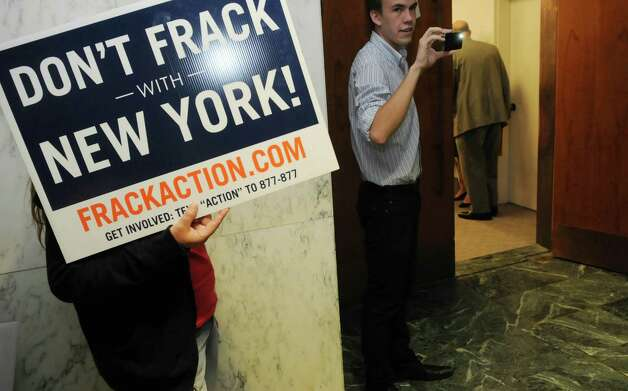 People opposed to natural gas drilling in New York State hold a rally just outside the room where members of a pro drilling group held a press conference at the Legislative Office Building on Thursday, June 14, 2012 in Albany, NY.  Members of the Joint Landowners Coalition held a press conference to highlight the areas in the southern area of the state that have shown support for natural gas drilling.   (Paul Buckowski / Times Union) Photo: Paul Buckowski
