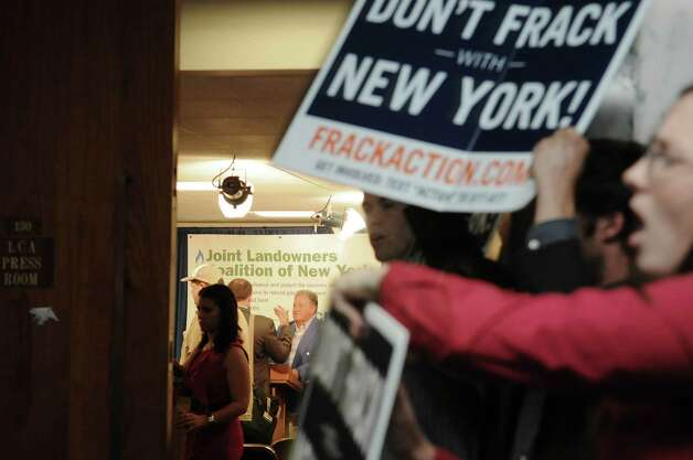 People opposed to natural gas drilling in New York State hold a rally just outside the room where members of a pro drilling group held a press conference at the Legislative Office Building on Thursday, June 14, 2012 in Albany, NY.  Members of the Joint Landowners Coalition held a press conference to highlight the areas in the southern area of the state that have shown support for natural gas drilling.   (Paul Buckowski / Times Union) Photo: Paul Buckowski / 00018099A