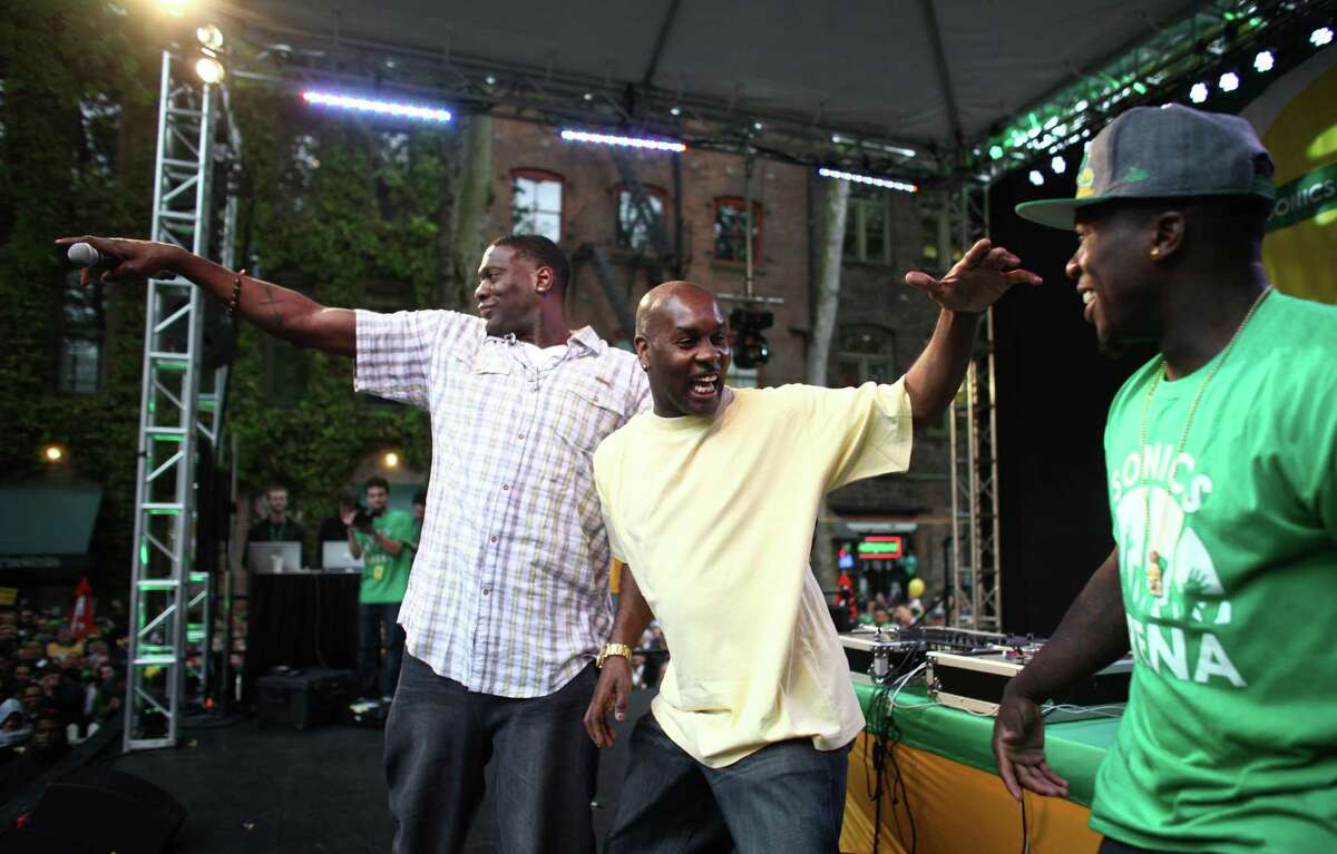From left, Shawn Kemp, Gary Payton and Nate Robinson take the stage during a rally to bring back the Seattle SuperSonics on Thursday, June 14, 2012. Thousands of people packed into Occidental Park to show support for bringing back an NBA team to Seattle.