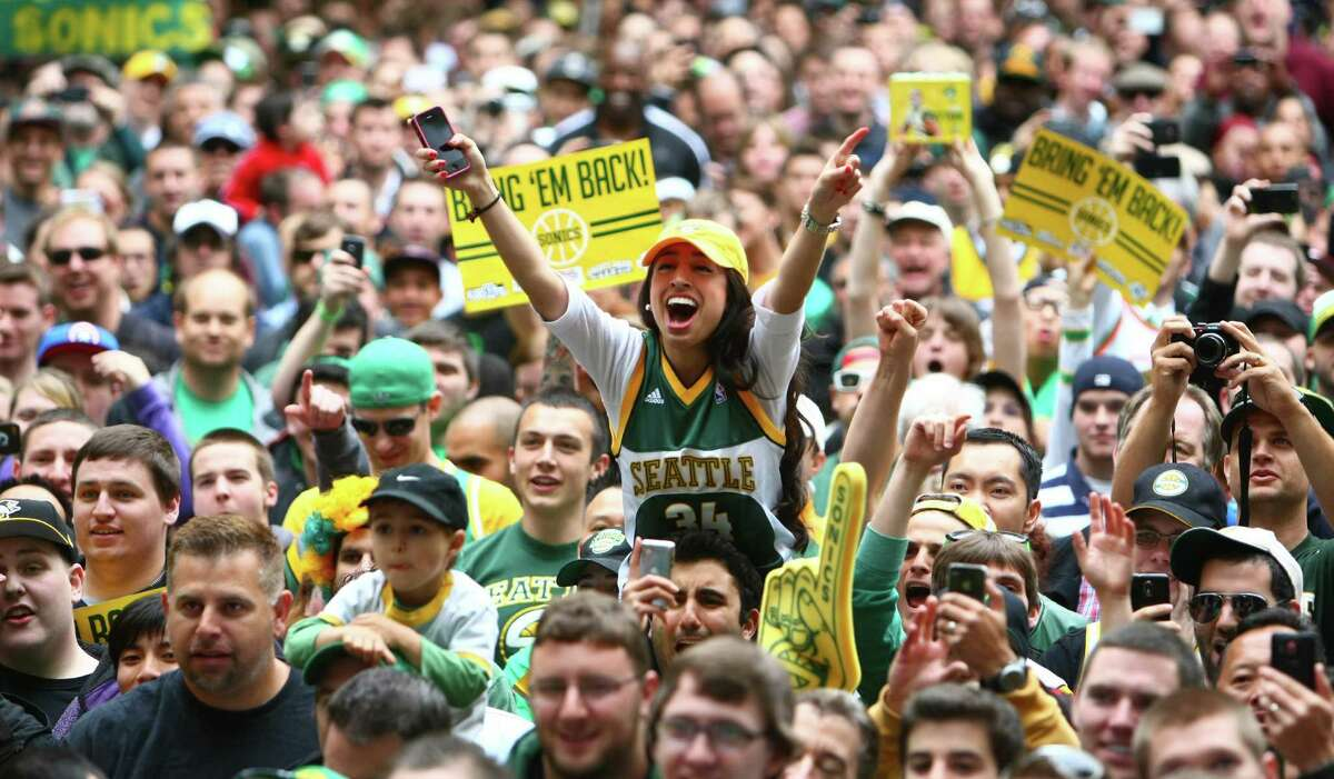 People pack into Occidental Park during a rally to bring back the Seattle SuperSonics. Thousands of people packed into Occidental Park to show support for bringing back an NBA team to Seattle.
