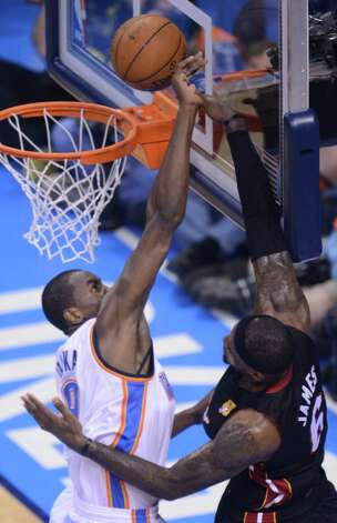 Serge Ibaka (L)  of the Oklahoma City Thunder and LeBron James of the Miami Heat vie for the ball during Game 2 of the NBA Finals at the Chesapeake Energy Arena in Oklahoma City, Oklahoma, June 14, 2012.  AFP PHOTO / ROBYN BECKROBYN BECK/AFP/GettyImages Photo: ROBYN BECK, AFP/Getty Images / AFP