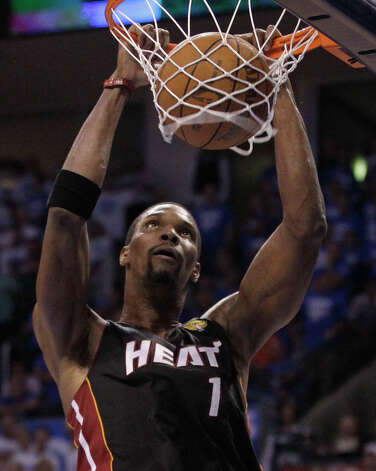 Miami Heat power forward Chris Bosh  dunks against the Oklahoma City Thunder during the second half at Game 2 of the NBA finals basketball series, Thursday, June 14, 2012, in Oklahoma City. (AP Photo/Jeff Roberson) Photo: Jeff Roberson, Associated Press / AP
