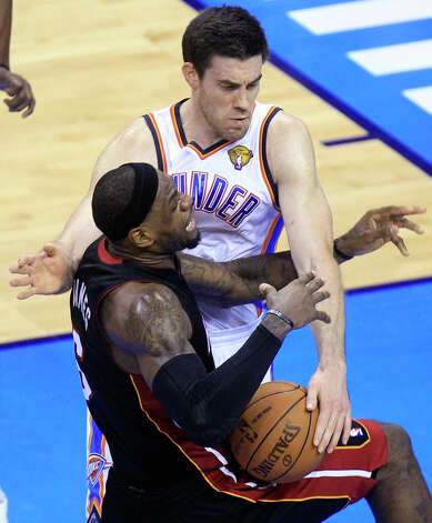 Oklahoma City Thunder power forward Nick Collison (4) fouls Miami Heat small forward LeBron James during the second half at Game 2 of the NBA finals basketball series, Thursday, June 14, 2012, in Oklahoma City. (AP Photo/Sue Ogrocki) Photo: Sue Ogrocki, Associated Press / AP