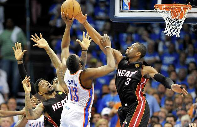 The Miami Heat's Dwyane Wade (3) blocks a shot by the Oklahoma City Thunder's James Harden in Game 2 of the NBA Finals on Thursday, June 14, 2012, at Chesapeake Energy Arena in Oklahoma City, Oklahoma. (Robert Duyos/Sun Sentinel/MCT) Photo: Robert Duyos, McClatchy-Tribune News Service / Sun Sentinel