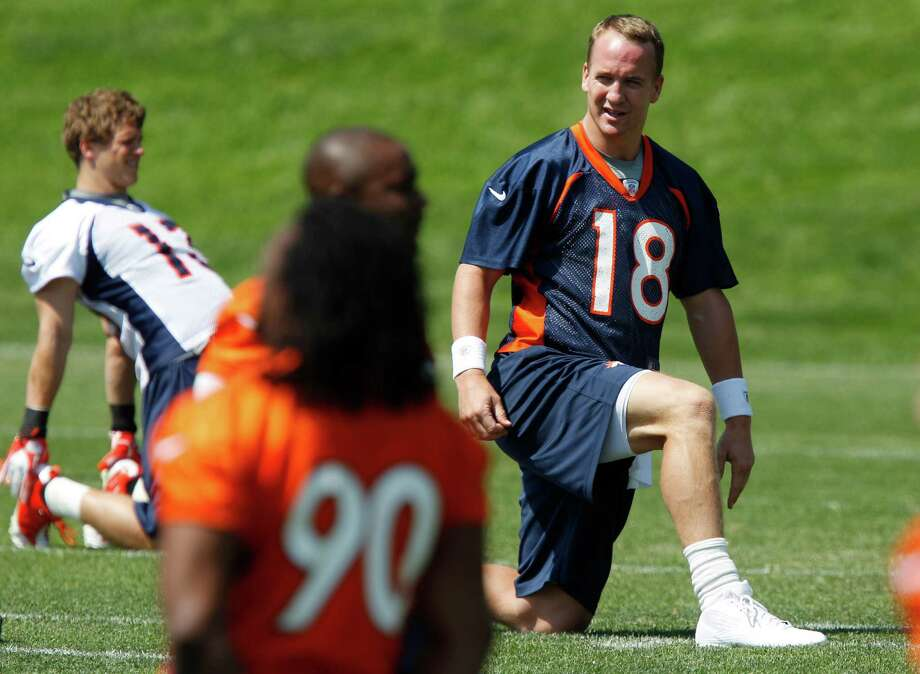 Denver Broncos quarterback Peyton Manning (18) stretches during an NFL football practice at the team's training facility in Englewood, Colo., on Thursday,  June 14, 2012. (AP Photo/David Zalubowski) Photo: David Zalubowski