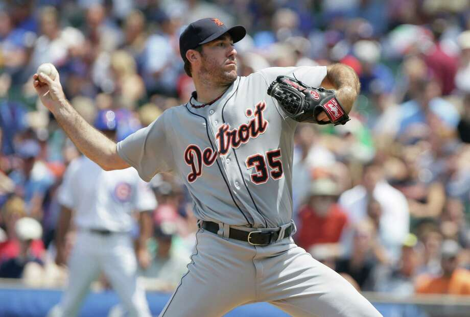 CHICAGO, IL - JUNE 14:  Justin Verlander #35 of the Detroit Tigers throws to the Chicago Cubs during the second inning of their MLB game at Wrigley field on June 14, 2012 in Chicago, Illinois. (Photo by John Gress/Getty Images) Photo: John Gress