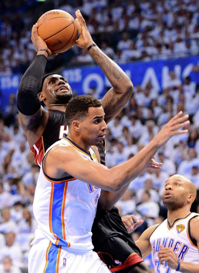 OKLAHOMA CITY, OK - JUNE 14:  LeBron James #6 of the Miami Heat goes up for a shot over Thabo Sefolosha #2 of the Oklahoma City Thunder in the third quarter in Game Two of the 2012 NBA Finals at Chesapeake Energy Arena on June 14, 2012 in Oklahoma City, Oklahoma. NOTE TO USER: User expressly acknowledges and agrees that, by downloading and or using this photograph, User is consenting to the terms and conditions of the Getty Images License Agreement.  (Photo by Ronald Martinez/Getty Images) Photo: Ronald Martinez