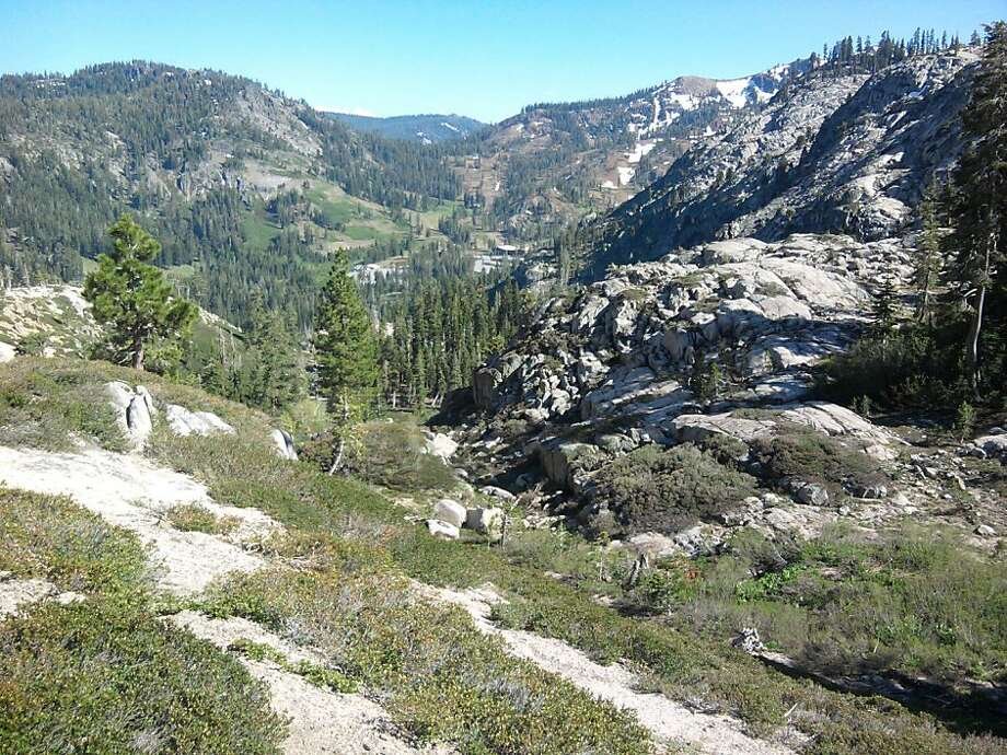 High on the trail near the ridge, the entire scope of the Alpine Meadows ski area opens up to your left
