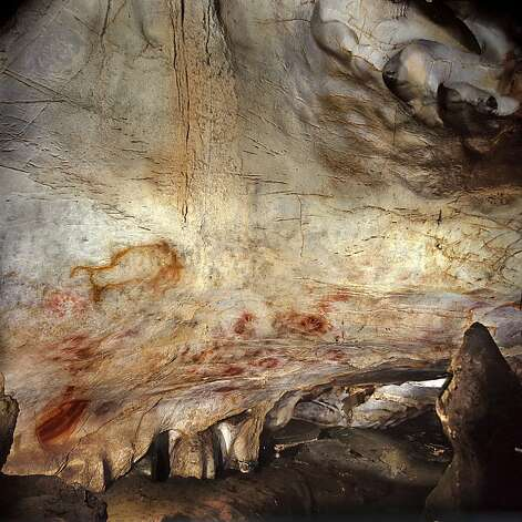 Hand stencils at the El Castillo Cave in Spain, which have been dated to have been created earlier than 37,300 years ago, in an undated handout photo. The paintings in northwestern Spain are far older than previously thought -- some of them more than 40,000 years old, scientists said on Thursday, June 14, 2012, raising a possibility that Neanderthals were the artists. (Pedro Saura/American Association for the Advancement of Science via The New York Times)  -- NO SALES; FOR EDITORIAL USE ONLY WITH STORY SLUGGED CAVE ART DATING BY JOHN NOBLE WILFORD. ALL OTHER USE PROHIBITED. -- Photo: Pedro Saura, New York Times