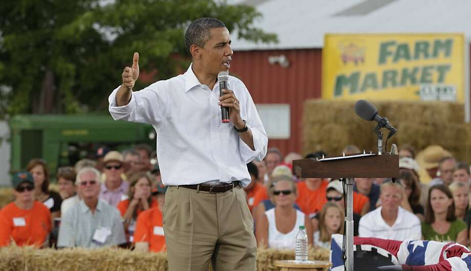 In this Aug. 17, 2011, photo, President Barack Obama speaks during a town hall meeting at Country Corner Farm Market in Alpha, Ill., during his three-day economic bus tour. Mitt Romney tells voters in small towns that he planted alfalfa on his uncle's farm as a teenager. And Obama doesn't hesitate to remind people in such far-flung places that his mother grew up in Kansas. So go the nostalgic pitches as each of the presidential candidates tries to connect with rural voters _ and convince them that only he can jump start a struggling economy.  (AP Photo/Carolyn Kaster) Photo: Carolyn Kaster, Associated Press