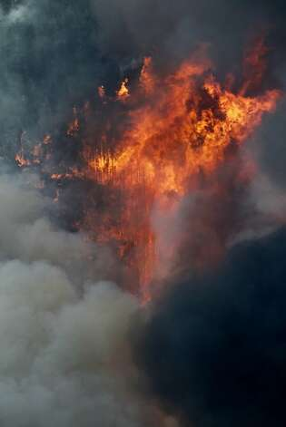Flames leap hundreds of feet in the air as the High Park wildfire fire explodes on the south side of Poudre Canyon west of Fort Collins, Colo., on Thursday, June 14, 2012. The wildfire started Saturday and has burned over 50,000 acres. (AP Photo/Ed Andrieski) Photo: Ed Andrieski, Associated Press