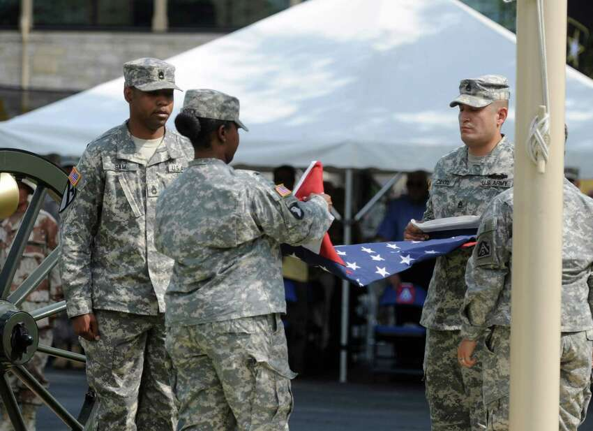 The flag of the United States is folded at the end of a retreat ceremony during a celebration of the Army's 237th birthday and Flag Day at the Fort Sam Houston Quadrangle on Thursday, June 14, 2012.