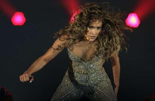 "Singer Jennifer Lopez performs during her ""Dance Again Tour"" in Panama City on June 14, 2012. She will appear with Enrique Inglesias at the AT&T Center on Aug. 23. (AP Photo/Arnulfo Franco) (AP)"