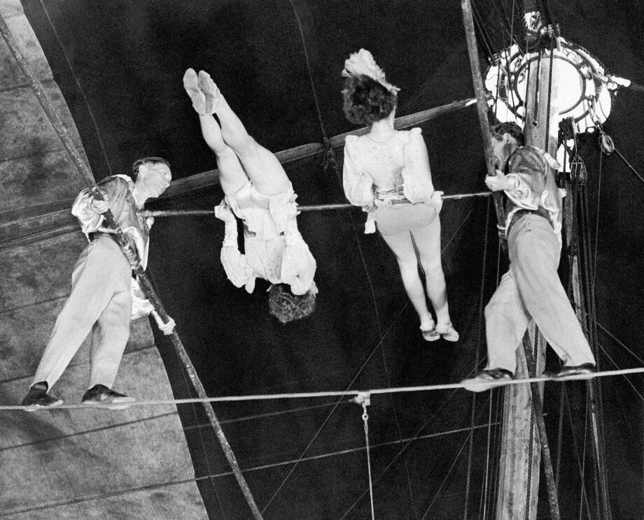 "FILE- In this April 15, 1944 photo, members of ""The Flying Wallendas,"" famous high wire act with the Ringling Bros. and Barnum & Bailey's Circus, perform their death-defying double pinwheel in Madison Square Garden in New York. From left are Herman, Henrietta, Helen, and Karl Wallenda. On Friday, June 15, 2012, Nik Wallenda, a seventh generation ""Flying Wallenda,"" will attempt a high-wire crossing of the Niagra Falls gorge between the United States and Canada. The event will be covered on live television. Photo: AP"