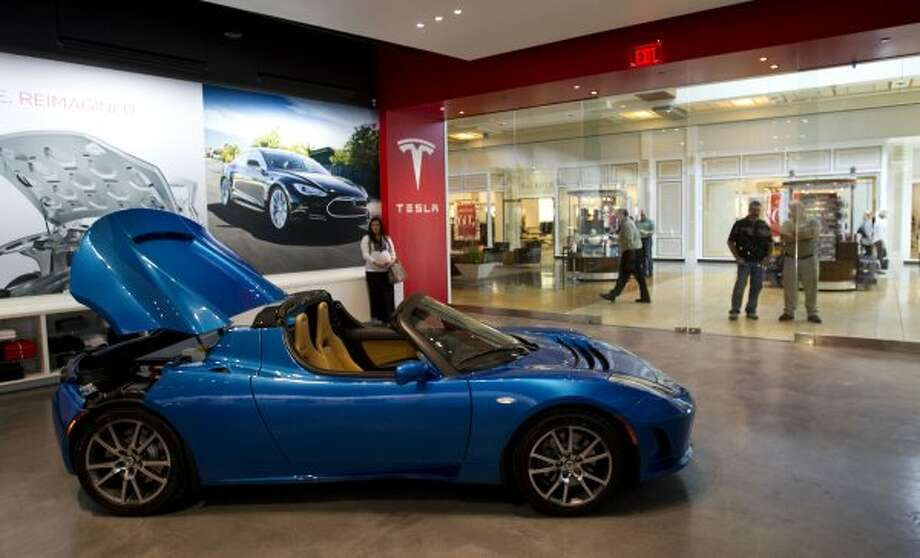 The Tesla Roadster is shown parked at the Tesla Gallery in the Galleria Thursday, Oct. 20, 2011, in Houston. Electric cars made by Tesla are the main attractions in the gallery. ( Brett Coomer / Houston Chronicle )