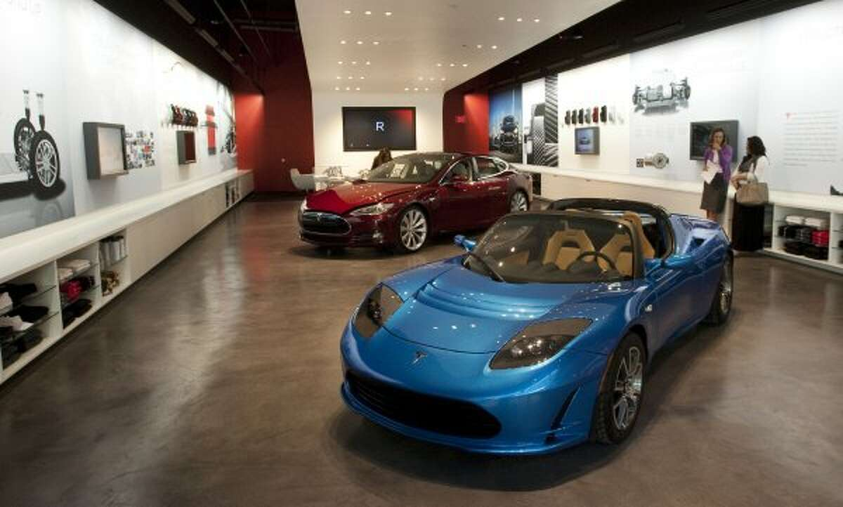 The Tesla Gallery in the Galleria is shown Thursday, Oct. 20, 2011, in Houston. Electric cars made by Tesla are the main attractions in the gallery. ( Brett Coomer / Houston Chronicle ) (Brett Coomer / Houston Chronicle)