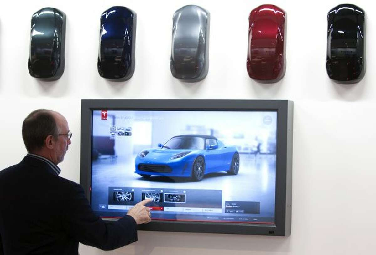 George Blankenship, vice president of worldwide sales for Tesla Motors, demonstrates the design studio computer at the Tesla Gallery in the Galleria Thursday, Oct. 20, 2011, in Houston. Electric cars made by Tesla are the main attractions in the gallery. ( Brett Coomer / Houston Chronicle ) (Brett Coomer / Houston Chronicle)