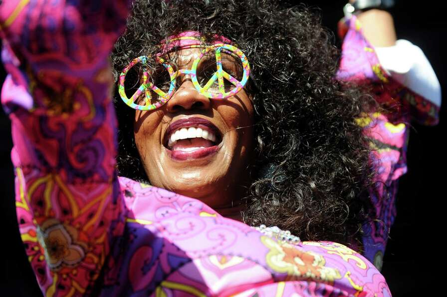 A 70s-style dancer entertains the audience as Bootsy Collins performs at Alive at Five on Thursday,