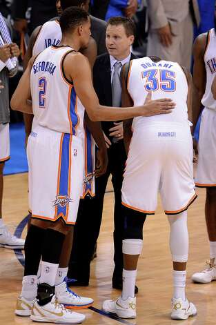 Oklahoma City Thunder's Thabo Sefolosha (L) and Kevin Durant (R) talk with coach Scott Brooks (C) during a time out in Game 2 of the NBA Finals at the Chesapeake Energy Arena in Oklahoma City, Oklahoma, June 14, 2012.  The Miami Heat defeated the Oklahoma City Thunder 100-96.   AFP PHOTO / ROBYN BECKROBYN BECK/AFP/GettyImages Photo: ROBYN BECK, AFP/Getty Images / AFP