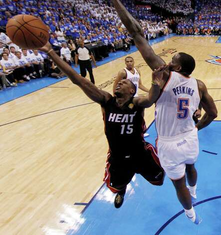 Miami Heat point guard Mario Chalmers  shoots as Oklahoma City Thunder center Kendrick Perkins (5) defends during the second half at Game 2 of the NBA finals basketball series, Thursday, June 14, 2012, in Oklahoma City. (AP Photo/Jim Young, Pool) Photo: Jim Young, Associated Press / Reuters Pool