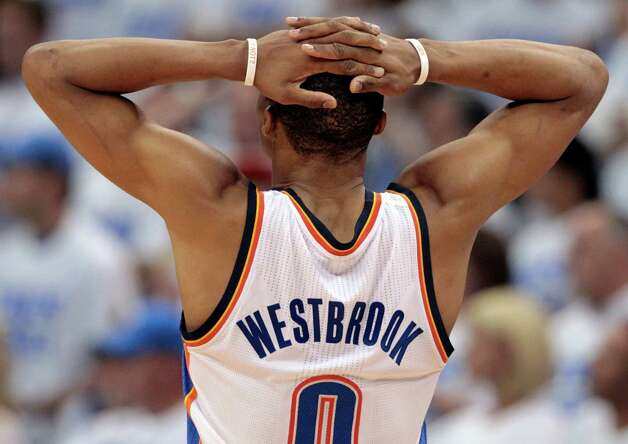 Oklahoma City Thunder point guard Russell Westbrook (0) pauses at a break against the Miami Heat during the second half at Game 2 of the NBA finals basketball series, Thursday, June 14, 2012, in Oklahoma City. (AP Photo/Jeff Roberson) Photo: Jeff Roberson, Associated Press / AP