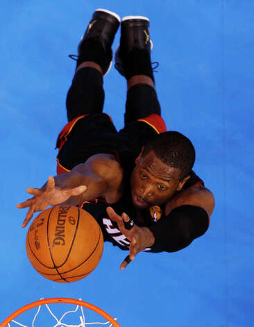 Miami Heat shooting guard Dwyane Wade (3) shoots against the Oklahoma City Thunder during the second half at Game 2 of the NBA finals basketball series, Thursday, June 14, 2012, in Oklahoma City. The Heat won 100-96. (AP Photo/Mike Ehrmann, Pool) Photo: Mike Ehrmann, Associated Press / Getty Pool